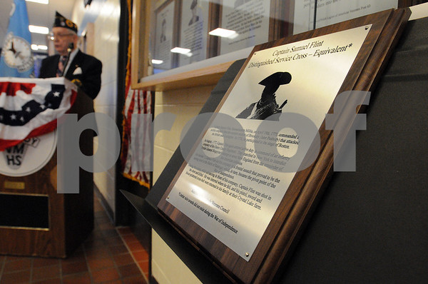 Peabody:<br /> Morris Sack, senior vice commander north shore post 220 jewish war veterans of america, speaks while the plaque commemorating a revolutionary soldier sits on a stand near the display case where it will eventually hang. The ceremony was at Peabody High School.<br /> Photo by Ken Yuszkus/Salem News, Friday, April 17, 2009.