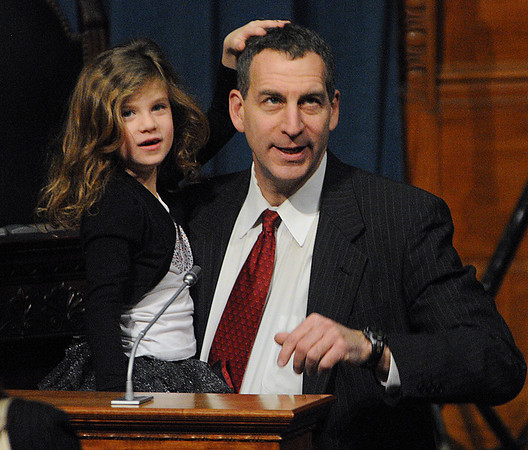 Boston:<br /> Jerry Parisella and his daughter Sophia at one of the podiums before he was sworn in as Beverly's new state representative at the Statehouse.<br /> Photo by Ken Yuszkus/Salem News, Wednesday, January 5, 2011.