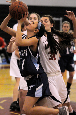 Marblehead:<br /> Peabody's Amanda Matthews left, goes up for a shot at the basket as Marblehead's McKenna Barrett tries to block her shot at the Peabody High School vs Marblehead High School girls varsity basketball game at Marblehead.<br /> Photo by Ken Yuszkus/Salem News, Tuesday, January 11, 2011.