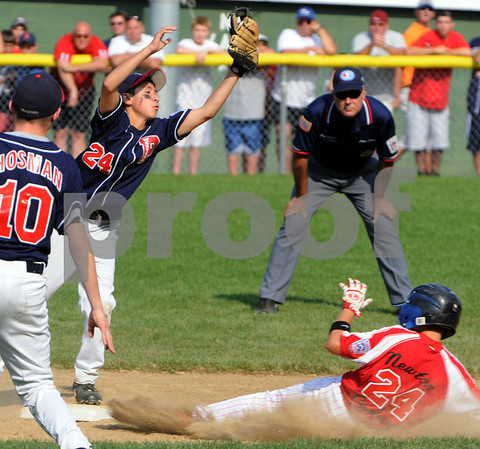 Beverly:<br /> Peabody West's Michael Petrosino gets the throw to get Newton Central's Theo Resnick out at second base during the State Little League championship game of Peabody West vs Newton Central at Harry Ball Field<br /> Photo by Ken Yuszkus/Salem News, Monday, August 3, 2009.