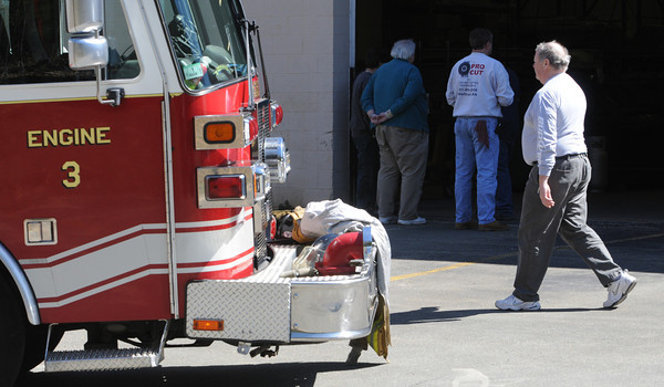 Ipswich:<br /> Dave Theriault, right, owner of D J Fabricators Inc., at the scene of a fire at 94 Turnpike Road on Wednesday morning.<br /> Photo by Ken Yuszkus/Salem News, Wednesday, April 4, 2012.