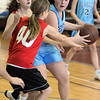Marblehead:<br /> Elizabeth Weisse, left,from the team, The Swish, tries to block Hannah Pellizzaro, from the team Blue Warriors, at the Jimmy Myers 3-on-3 Basketball Tournament held at the JCC of the North Shore.<br /> Photo by Ken Yuszkus/Salem News, Monday, January 16, 2012.