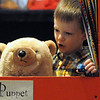 Wenham:<br /> Derek Langenau, 3 1/2, plays with a hand puppet during a program for young children at the PuppetPalooza exhibit at the Wenham Museum on Friday morning. The program allowed the children to play with many types of puppets.<br /> Photo by Ken Yuszkus/Salem News, Friday, December 9, 2011.