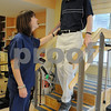 Swampscott:<br /> Kristen Arvidson, senior physical therapist, works with Bill Culbert, who is climbing stairs in the gym at the Aviv Centers for Living Jewish Rehabilitation Center.<br /> Photo by Ken Yuszkus/Salem News, Thursday, July 16, 2009.