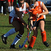 Boxford:<br /> Masconomet's Pam Herter, left, and Ipswich's Liz Gallagher, fight over the ball at the Ipswich at Masconomet field hockey game.<br /> Photo by Ken Yuszkus/Salem News, Thursday, October 7, 2010.