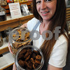 Salem:<br /> Nancy Ripa, owner of Living With Pets, holds a jar of peanut butter organic dog treats and also coconut carob organic dog treats near her display of many other flavors at her store. The treats were two of many she had on sale at the Salem Farmers Market two weeks ago. The Salem Board of Health told Ripa she couldn't sell her organic dog treats at the Salem Farmers Market, because they weren't prepared in a certified kitchen.<br /> Photo by Ken Yuszkus/Salem News, Tuesday, August 11, 2009.