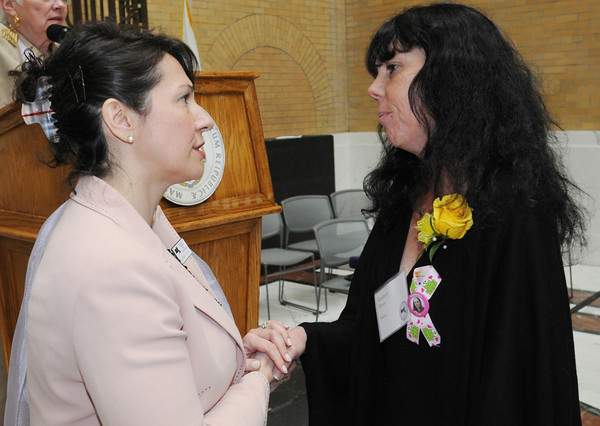 Boston:<br /> Victoria Budson, left, chairwoman of the Massachusetts Commission on the Status of Women, meets with Kimberly Flynn of Peabody, who is one of the 88 nominees, at the conclusion of the Ninth Annual Unsung Heroines of Massachusetts program at the state house.<br /> Photo by Ken Yuszkus/Salem News, Wednesday, May 16, 2012.