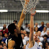 Danvers:<br /> Danvers' Eric Martin reaches to guide the ball into the net during the Winthrop at Danvers bys basketball game.<br /> Photo by Ken Yuszkus/Salem News, Monday, February 13, 2012.