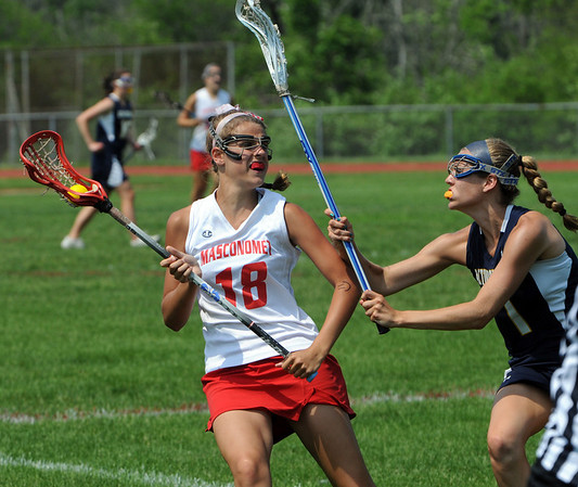 Topsfield:<br /> Masco's Becca Phillips, left, hits the defense of Acton Boxborough player, Sarah Smith, during the Acton Boxborough at Masconomet girls lacrosse state tournament game.<br /> Photo by Ken Yuszkus/Salem News, Wednesday, June 1, 2011.