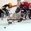 Peabody:<br /> Bishop Fenwick's #3 Tyler Burgess and Lynn's #19 Jack Ereckson, fight for the puck in front of the Lynn goal during the Lynn vs Bishop Fenwick hockey game at McVann-O'Keefe Rink.<br /> Photo by Ken Yuszkus/Salem News, Friday,  February 20, 2009