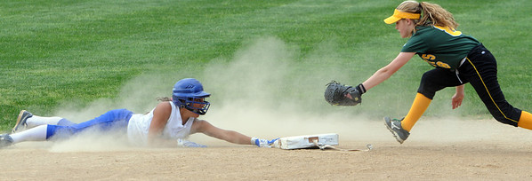 Danvers:<br /> Danvers' Janelle Saggese, left, slid safely into second on a steal as North Reading's Meredith Moise scrambles to tag her during the North Reading at Danvers Division 2 North first round state tournament game.<br /> Photo by Ken Yuszkus/Salem News, Thursday, June 2, 2011.