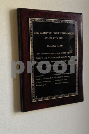 "Salem:<br /> Plaque on wall of city hall to Samuel McIntire eagle restoration on roof of the building. Only McIntire is spelled ""McIntyre."" <br /> Photo by Ken Yuszkus/Salem News, Tuesday March 3, 2009."