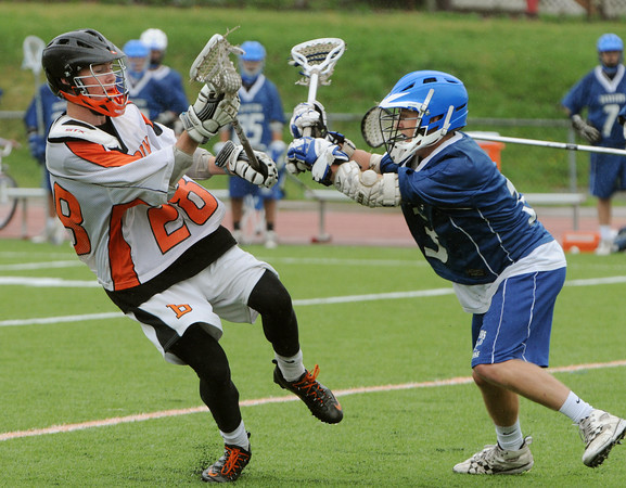 Beverly:<br /> Beverly's Connor Leahy, left, was pushed by Danvers' Matt Flynn, but does not fall during the Danvers at Beverly boys lacrosse game.<br /> Photo by Ken Yuszkus/Salem News, Monday, April 23, 2012.