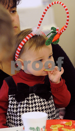 Peabody:<br /> Sophia Leyden, 1 year old, from Newburyport, eats a pancake at the Breakfast With Santa at the South Branch Library while waiting for Santa to arrive. Lolly Summit of Peabody is holding Sophia.<br /> Photo by Ken Yuszkus/Salem News, Wednesday December 10, 2008.
