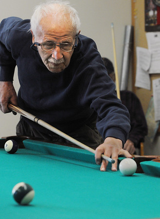 Beverly:<br /> Rafaele Laurenzo makes his shot while playing eight ball at the Council On Aging Senior Community Center.<br /> Photo by Ken Yuszkus/Salem News, Thursday, December 8, 2011.