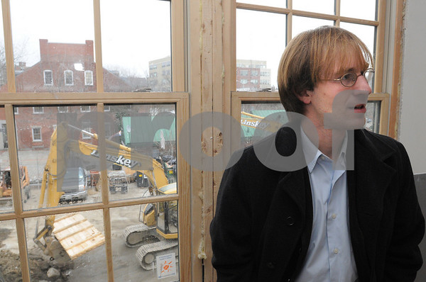 Salem:<br /> Matt Picarsic, of RCG, stands near a window in an apartment which is undergoing construction inside the Central House which is being converted into apartments and retail space by the developer.<br /> Photo by Ken Yuszkus/Salem News, Tuesday December 9, 2008.