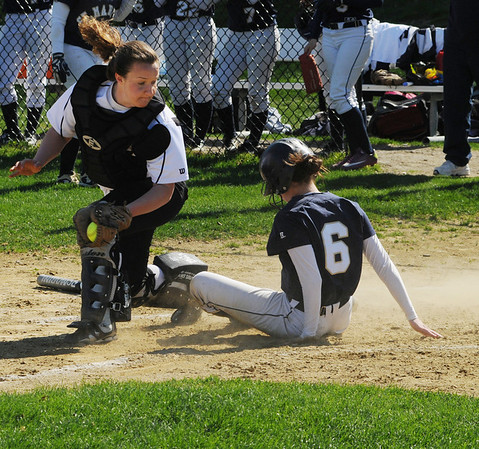 Danvers:<br /> St. Mary's Lynn Sabrina Iannetti slides in safe at home by Bishop Fenwick's catcher Alyssa Bornstein at the St. Mary's Lynn at Bishop Fenwick softball game on Monday afternoon.<br /> Photo by Ken Yuszkus/Salem News, Monday, May 2, 2011.