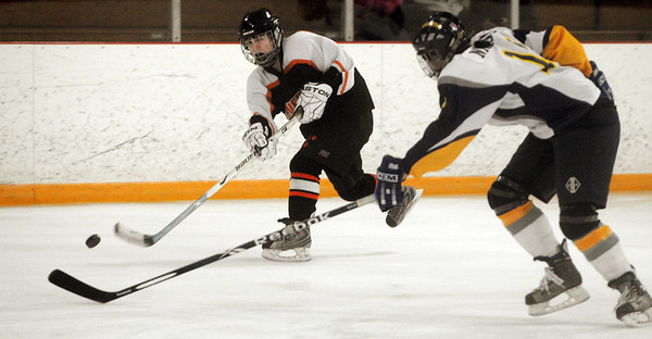 Lexington:<br /> Beverly's Nicole Woods lets loose a shot at the net during the Beverly High girls hockey Division 1 playoff game at Lexington.<br /> Photo by Ken Yuszkus/Salem News, Wednesday,  February 29, 2012.