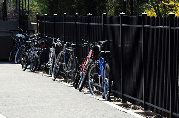 Hamilton:<br /> Bicycles leaning on a fence at the railroad station in Hamilton.<br /> Photo by Ken Yuszkus/Salem News, Monday, April 16, 2012.
