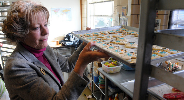 Lynn:<br /> Swampscott resident Sandra Rhoads owns Starlight Creatives. Sandra started baking and decorating cookies in her Swampscott home. Seven years later, her cookie business is booming. She is holding a tray of Frosty sugar cookies.<br /> Photo by Ken Yuszkus/Salem News, Thursday,  December 9, 2010.