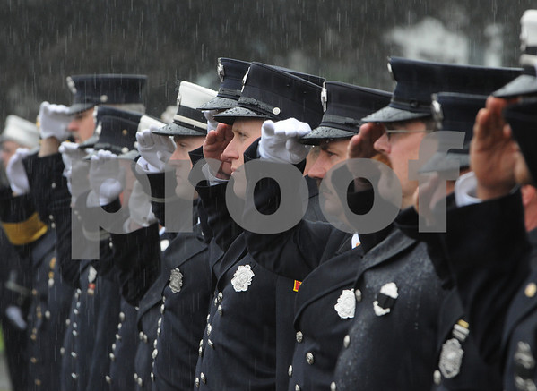 Beverly:<br /> Firefighters from various cities and towns salute in the rain as the casket of Beverly firefighter Paul Roberts is carried into Immanuel Congregational Church for his funeral.<br /> Photo by Ken Yuszkus/Salem News, Friday May 29, 2009.