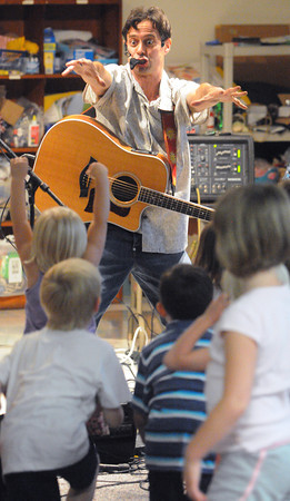 Swampscott:<br /> Philip Alexander entertains the crowd during the party to kickoff the Swampscott Public Library's summer reading program.<br /> Photo by Ken Yuszkus/Salem News, Tuesday, June 26, 2012.