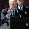 Salem:<br /> Former chief Robert St. Pierre, left, speaks at the podium while Police Chief Paul Tucker stands behind him at the renaming of the Salem Police Station ceremony. The name of the police station was renamed for former chief Robert St. Pierre.<br /> Photo by Ken Yuszkus/Salem News, Tuesday, May 11, 2010.