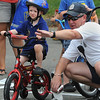 Beverly:<br /> Salem police officer Jay Derobertis directs Harrison Stanton, 3, at the start of the bicycle course during the Bicycle Safety Rodeo at Lynch Park. The Beverly Kiwanis Club and Beverly Police Department sponsored the annual Bicycle Safety Rodeo as part of the Beverly Homecoming.<br /> Photo by Ken Yuszkus/Salem News, Monday, August 1, 2011.