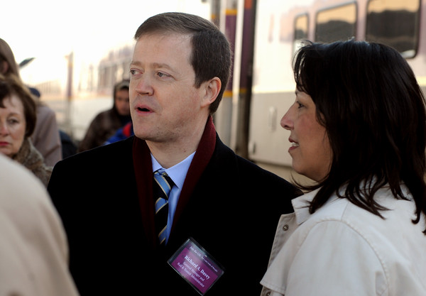 "Salem:<br /> MBTA general manager Richard Davey, left, speaks with Salem Mayor Kim Driscoll on the train platform at the Salem train station. Richard Davey held his 20th ""Join the GM"" session since he joined the T a year ago.<br /> Photo by Ken Yuszkus/Salem News, Thursday, April 7, 2011."