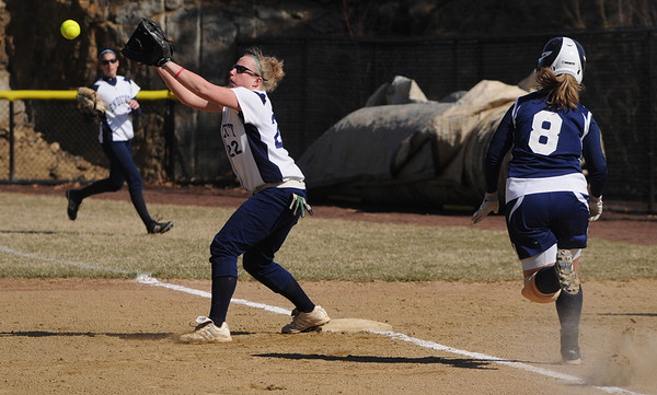Beverly:<br /> Nicole Devlin, Endicott College's first baseman, reaches for the throw to first and gets Gordon's Kristen Terry out during the Gordon at Endicott College softball game.<br /> Photo by Ken Yuszkus/Salem News, Tuesday, March 29, 2011.