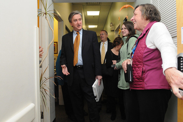 Salem:<br /> Congressman John Tierney, D-Salem, tours the Salem Family Health Center accompanied by Gloria Riley, COO/HR director at the center, who is holding open a door.<br /> Photo by Ken Yuszkus/Salem News, Tuesday, March 30, 2010.