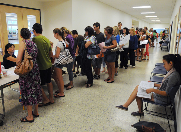 Beverly:<br /> A long line formed at Beverly High School on Monday morning at the table where paperwork had to be filled out and the lease payments worked out.<br /> Photo by Ken Yuszkus/Salem News, Monday, August 15, 2011.