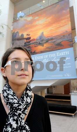 Salem:<br /> Jessica Barry, Endicott College senior, stands near a banner for the To the Ends of the Earth, Painting the Polar Landscape exhibit, which she worked on at the Peabody Essex Museum while interning.<br /> Photo by Ken Yuszkus/Salem News, Monday, November 10, 2008.