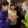 Ipswich:<br /> From left, visiting Chinese students Zhang Xinge and Yu Panwen speak with Hannah Wallis, 8th grader, in the hallway at the Ipswich Middle School.<br /> Photo by Ken Yuszkus/Salem News, Monday, February 22, 2010.