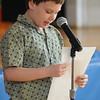 "Wenham:<br /> Jonathan Purdy, third-grader at the Buker Elementary School, reads his original poem in front of the school audience as part of the ""Read Across America"" program Friday morning.<br /> Photo by Ken Yuszkus/Salem News, Friday,  March 9, 2012."