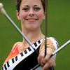 Danvers:<br /> Katie Yeaton poses with her batons. She twirls flaming batons for the Danvers High Falcon Band.<br /> Photo by Ken Yuszkus/Salem News,  Tuesday,  November 23, 2010.
