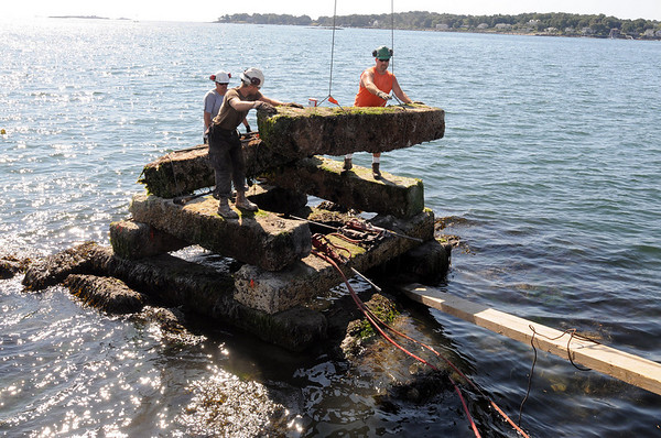 Salem:<br /> Rebuilding Abbot Rock in Salem Harbor, workers place granite pieces into place.<br /> Photo by Ken Yuszkus/Salem News, Friday August 13, 2010.