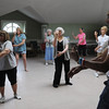 Salem:<br /> Ben Hernando, right, leads a Tai Chi class at the Salem Council on Aging on Friday morning.<br /> Photo by Ken Yuszkus/Salem News, Friday, June 17, 2011.