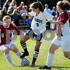 Peabody:<br /> Peabody's Emily Manoogian works the ball while being sandwiched by Lynn English players,left, Mackenzie Clark and right, Cara Crowley, during the Lynn English at Peabody girls soccer game.<br /> Photo by Ken Yuszkus/Salem News, Tuesday, September 15, 2009.