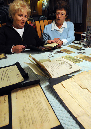 Beverly:<br /> Valerie Buckman, left, and Ellen Eisen have World War II letters and other documents and relics from their father, Arthur Sidell, spread out on a table. Arthur Sidell was a prisoner of war during the war. <br /> Photo by Ken Yuszkus/Salem News,  Tuesday,  November 9, 2010.
