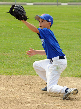 Topsfield:<br /> Kevin Lucey, of the Topsfield Little League, practices for the District 15 tourney.<br /> Photo by Ken Yuszkus/Salem News, Tuesday, June 28, 2011.