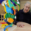 Manchester:<br /> Stephen Bates, who played clarinet with the Kennedy Center Opera Orchestra for three decades, will debut a new composition during the upcoming Music at Eden's Edge concerts. He is near a new untitled art piece he created.<br /> Photo by Ken Yuszkus/Salem News, Monday, June 20, 2011.