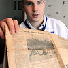Danvers:<br /> Chris Kontos, is the fourth member of his family to be a hockey captain at Danvers High. He is holding a copy of the Salem News from 1946 where his grandfather is pictured.<br /> Photo by Ken Yuszkus/Salem News, Tuesday, February 16, 2010.