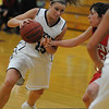 Beverly:<br /> Brittany Kelleher protects the ball from prying hands during the Endicott women's basketball game vs. Keene State at Post Center gymnasium at Endicott College.<br /> Photo by Ken Yuszkus/Salem News, Tuesday,  December 7, 2010.
