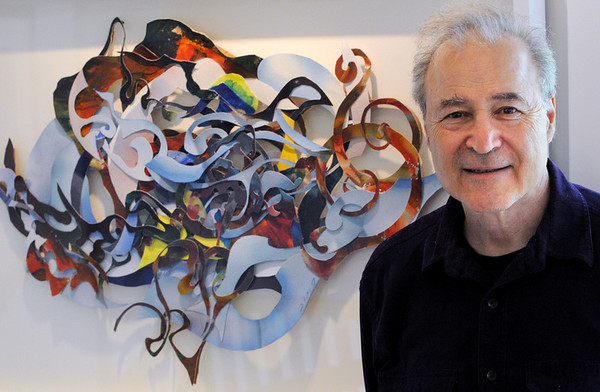 Manchester:<br /> Stephen Bates, who played clarinet with the Kennedy Center Opera Orchestra for three decades, will debut a new composition during the upcoming Music at Eden's Edge concerts. He is standing near a piece of art he created named, On Pointe, at his home.<br /> Photo by Ken Yuszkus/Salem News, Monday, June 20, 2011.