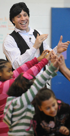 """Danvers:<br /> Casey Preston, an actor portraying Abraham Lincoln, leads students line dancing during his presentation, """"Abraham Lincoln: American President"""", at the Highlands Elementary School.<br /> Photo by Ken Yuszkus/Salem News, Tuesday, February 2, 2010."""