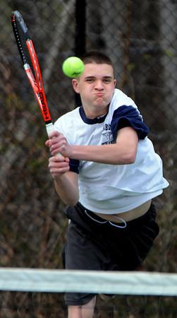 Swampscott:<br /> Peabody's Mike Warren returns the ball during the Peabody at Swampscott boys tennis match at Swampscott Middle School tennis courts.<br /> Photo by Ken Yuszkus/Salem News, Monday, April 9, 2012.