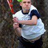 Swampscott:<br /> Peabody's Mike Warren returns the ball during the Peabody at Swampscott boys tennis match at Swampscott Middle School tennis courts.<br /> Photo by Ken Yuszkus/Salem News, Monday, April 9, 2012.