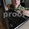 Salem:<br /> Jakub Fila, 15, has congenital Muscular Dystrophy and other illnesses. A nonprofit organization gave him the laptop he had wished for <br /> Photo by Ken Yuszkus/Salem News, Tuesday, August 11, 2009.