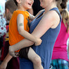 Danvers:<br /> Megan Glidden dances to the music while holding her son Andrew, 5, both from Danvers, at the Danvers Family Festival held in Danvers Square.<br /> Photo by Ken Yuszkus/Salem News, Thursday, June 28,  2012.